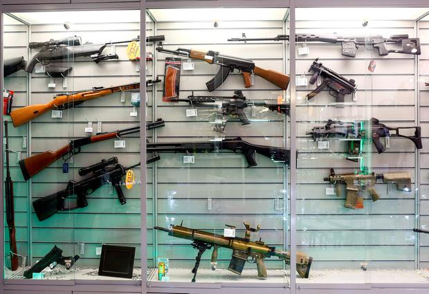 Air guns are seen in a showcase of a gunsmith's shop in Berlin, Germany, January 8, 2016. Demand for pepper spray and blank-firing guns has surged in Germany, particularly after militant attacks in Paris in November and assaults on women in Cologne on New Year's Eve. REUTERS/Hannibal Hanschke
