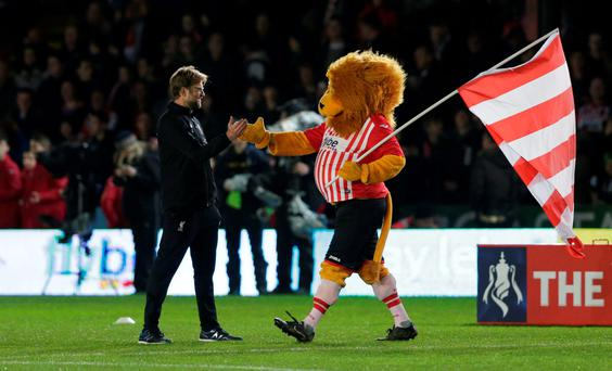 Liverpool manager Juergen Klopp with the Exeter City mascot before the game