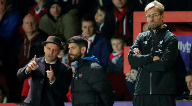Liverpool manager Juergen Klopp and Exeter City manager Paul Tisdale (L)