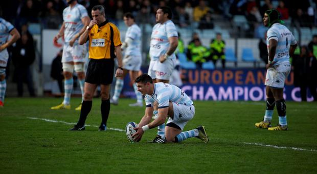 Racing Metro's out-half Dan Carter prepares to kick the ball during the Champions Cup