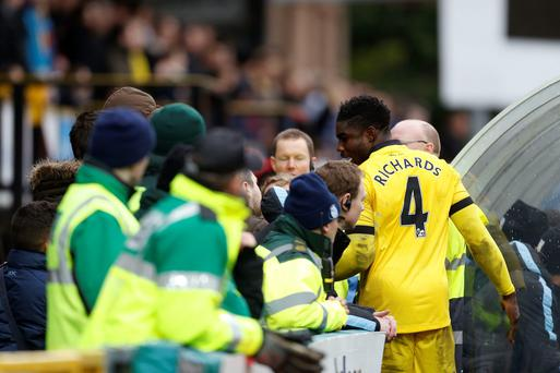 Aston Villa's Micah Richards has an altercation with Wycombe supporters in the crowd during the Emirates FA Cup, third round game at Adams Park