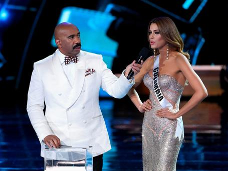 Host Steve Harvey (L) listens as Miss Colombia 2015, Ariadna Gutierrez Arevalo, answers a question during the interview portion of the 2015 Miss Universe Pageant at The Axis at Planet Hollywood Resort & Casino on December 20, 2015 in Las Vegas, Nevada. (Photo by Ethan Miller/Getty Images)