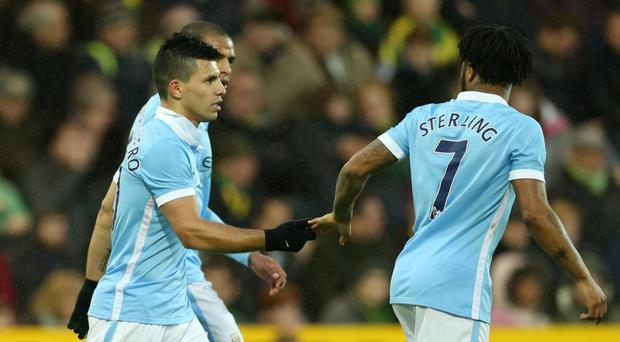 Manchester City's Sergio Aguero celebrates with Raheem Sterling after scoring their first goal