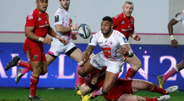 Stade Francais Paris' Waisea passes the ball during the European Champions Cup match between Stade Francais and Munster