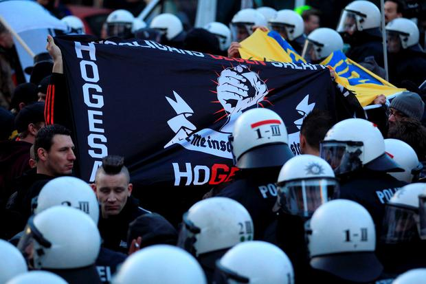 Supporters of HoGeSa (hooligans against Salafists) take part in a demonstration march with anti-immigration right-wing movement PEGIDA (Patriotic Europeans Against the Islamisation of the West) in reaction to mass assaults on women on New Year's Eve, in Cologne, Germany, January 9, 2016. REUTERS/Ina Fassbender