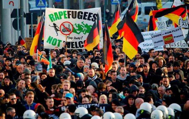 Supporters of anti-immigration right-wing movement PEGIDA (Patriotic Europeans Against the Islamisation of the West) take part in in demonstration rall REUTERS/Wolfgang Rattay