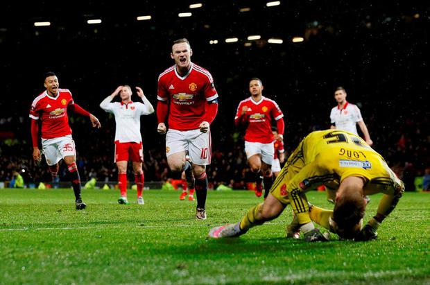 Manchester United's Wayne Rooney celebrates scoring their winning goal with a penalty