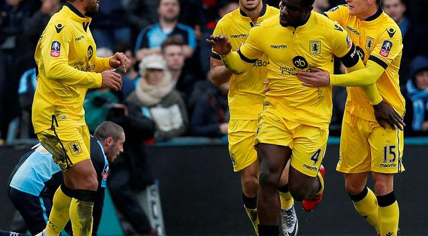 Aston Villa's Micah Richards celebrates his goal during the FA Cup game against Wycombe Wanderers yesterday. Photo: Ian Kington