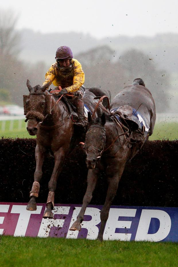 Mountainous ridden by Jamie Moore clears the last fence before going on to win The Coral Welsh Grand National at Chepstow Photo:Getty