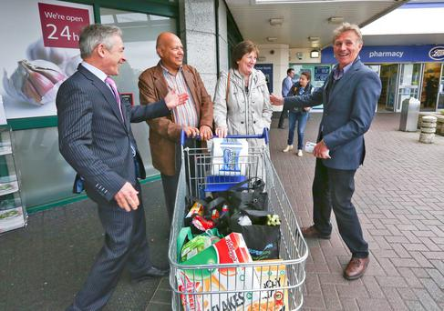 19/05/14 Fine Gael Local Election Candidate, Eamonn Coghlan and Minister Richard Bruton pictured canvassing Miriam and Ashok Varadkar, the parents of Transport Minister, Leo Varadkar this afternoon at the Roselawn Shopping Centre, Castleknock, Dublin ....Picture Colin Keegan, Collins Dublin.