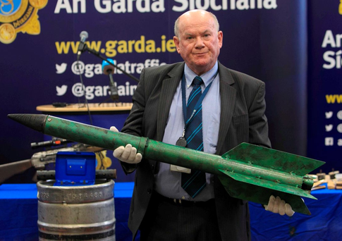 06/01/2016 Garda Detective Sergeant Thomas Carey holding an improvised rocket during a display of weapons seized during the years 2014 and 2015 at Garda Headquarters,Dublin. The weapons were seized as part of on-going Garda efforts to disrupt the activities of dissident republicans. Photo: Gareth Chaney Collins