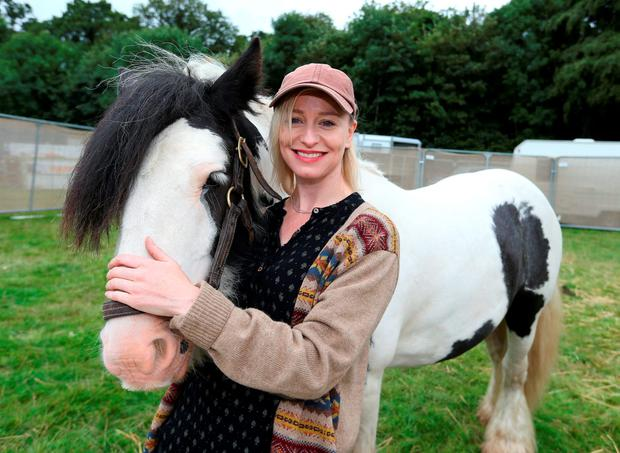 Singer, Cathy Davey with Charles the pony, Cathy will host My Lovely Ranch, a collective of horses, donkeys, and dogs to hang with for the weekend, at a sneak preview of the Electric Picnic site in Stradbally, Co. Laois. Picture credit; Damien Eagers 26/8/2014