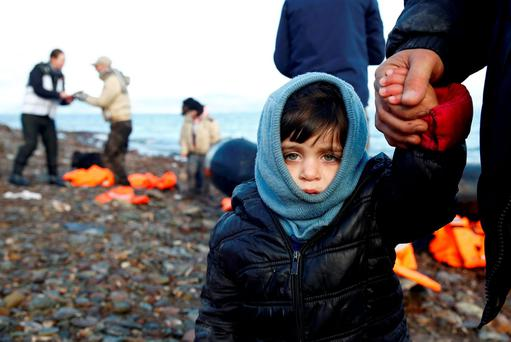 A Syrian refugee child looks on, moments after arriving on a raft with other Syrian refugees on a beach on the Greek island of Lesbos, January 4, 2016. REUTERS/Giorgos Moutafis TPX IMAGES OF THE DAY