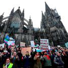 MASS ATTACKS: People protest against violence against women at the cathedral in Cologne yesterday after more than 150 women were subjected to sexual assaults in the city on New Year's Eve, by what was described as organised groups of up to 1,000 men of North African or Arab appearance Photo:AFP/Getty