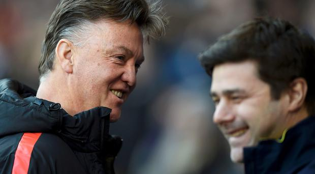 Tottenham Hotspur manager Mauricio Pochettino speaks to Manchester United manager Louis van Gaal