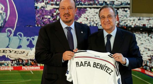 Real Madrid president Florentino Perez presents Rafa Benitez at the Santiago Bernabeu last June