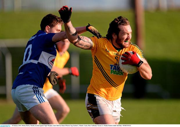 Mickey Burke of Meath in action against Nigel Murphy in the Bord na Mona O'Byrne Cup. Picture credit: Seb Daly / SPORTSFILE