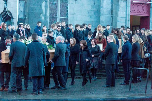 Mourners carry the coffin at the funeral of Michael Bugler at Ennis Cathedral on Sunday