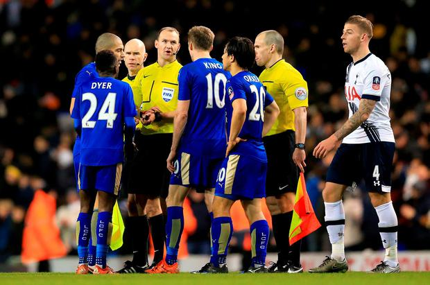 Leicester City players speak with referee Bobby Madley after the Emirates FA Cup, third round match at White Hart Lane, London