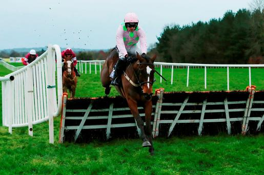 Min, under Ruby Walsh, cruises to victory in Saturday's Moscow Flyer Hurdle at Punchestown Photo: Niall Carson/PA