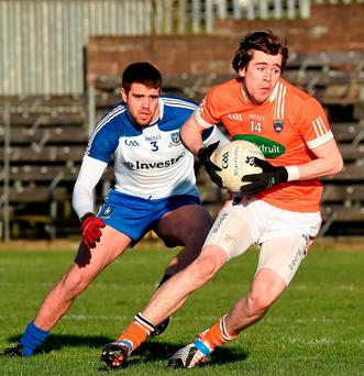 Armagh's Andrew Murnin in action against Monaghan's Drew Wylie during the McKenna Cup, Group C, Round 2,clash at St Tiernach's Park. Photo: Philip Fitzpatrick / Sportsfile