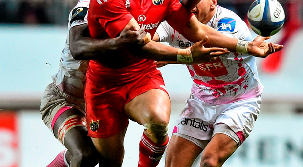 Munster's Francis Saili is tackled by Stade Francais' Sekou Macalou, left, and Julien Arias during Saturday's Champions Cup clash in Paris. Picture credit: Ramsey Cardy / Sportsfile