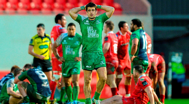 A dejected Tiernan O'Halloran after Connacht's narrow defeat to the Scarlets in Parc Y Scarlets yesterday. Picture credit: Chris Fairweather / Sportsfile