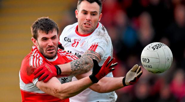 Mark Lynch, Derry, in action against Tyrone/s Cathal McCarron during their Dr. McKenna Cup, Group A, Round 2, clash at Derry GAA Centre of Excellence. Photo: Stephen McCarthy / Sportsfile
