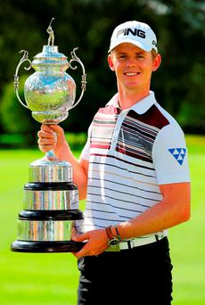 Brandon Stone poses with the South African Open trophy following his victory in the BMW SA Open at Glendower Golf Club, Johannesburg. Photo: Richard Heathcote/Getty Images