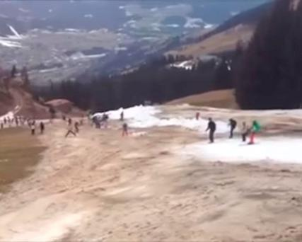 Skiers try and stay on the thin makeshift snow track (Photo: YouTube/The Local)
