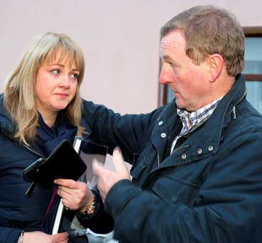 A tearful Irene Shiel from Craughwell, Co Galway, challenges Taoiseach Enda Kenny about the floods that forced her parents out of their home Photo: Hany Marzouk