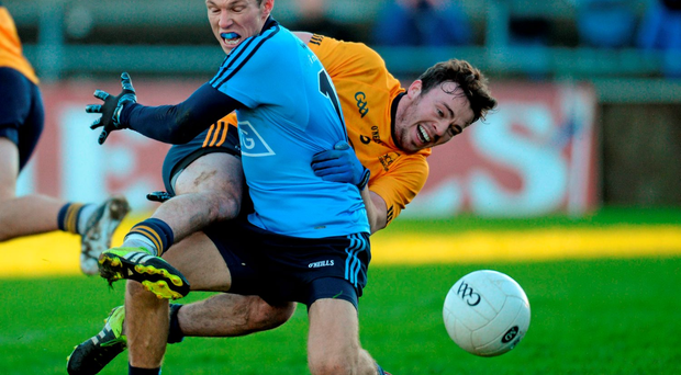 Dublin's Darren Daly battles for possession with DCU's Conor Moynagh. Picture credit: Paul Mohan / Sportsfile