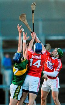 Kerry's Jason Diggins attempts to gain possession against Cork pair Luke O'Farrell (14) and Alan Cadogan during their Munster Senior Hurling League clash in Mallow. Photo: Eoin Noonan / Sportsfile