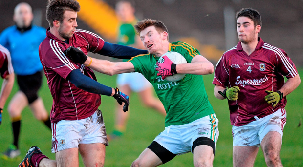 Leitrim's Shane Quinn holds off Galway's Paul Conroy. Picture credit: Ray Ryan / Sportsfile