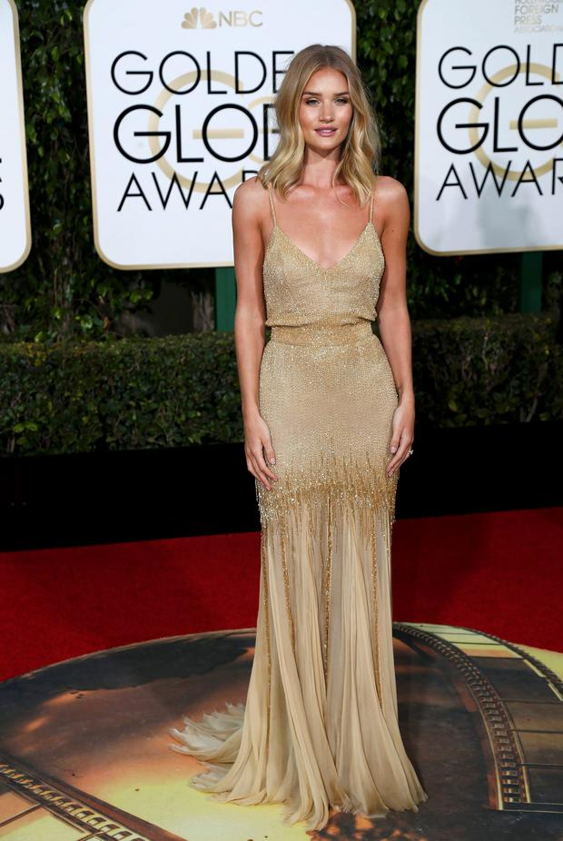 Rosie Huntington-Whiteley arrives at the 73rd Golden Globe Awards in Beverly Hills, California January 10, 2016. REUTERS/Mario Anzuoni