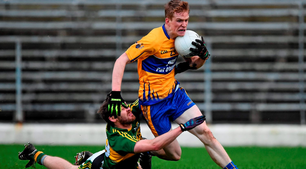 Pierce Lillis, Clare, is tackled by Kieran Crowley, Kerry, resulting in a black card for Crowley. Picture credit: Brendan Moran / SPORTSFILE