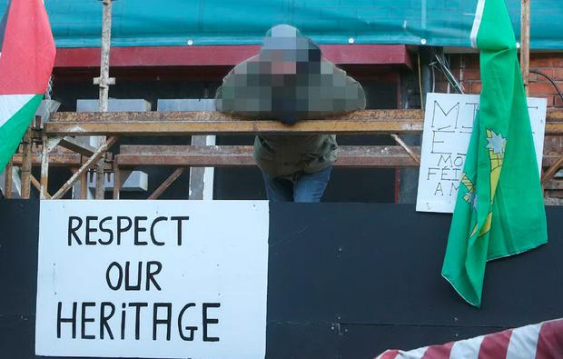 A protester occupying the 1916 National Monument on Dublin's Moore Street. Photo: Damien Eagers