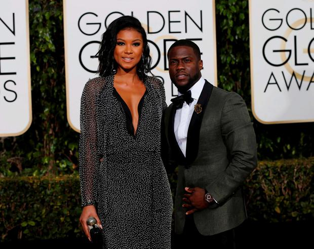 Actor Kevin Hart arrives with Eniko Parrish at the 73rd Golden Globe Awards in Beverly Hills, California January 10, 2016. REUTERS/Mario Anzuoni