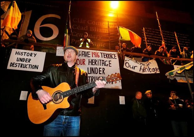 Damien Dempsey performing outside the occupied buildings on Moore Street. Photo: Steve Humphreys