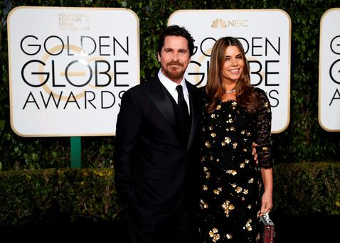 Actor Christian Bale and wife, actress Sibi Blazic, arrive at the 73rd Golden Globe Awards in Beverly Hills, California January 10, 2016. REUTERS/Mario Anzuoni