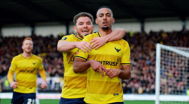 Oxford's Kemar Roofe celebrates scoring his team's third goal. Photo: Reuters / Tony O'Brien