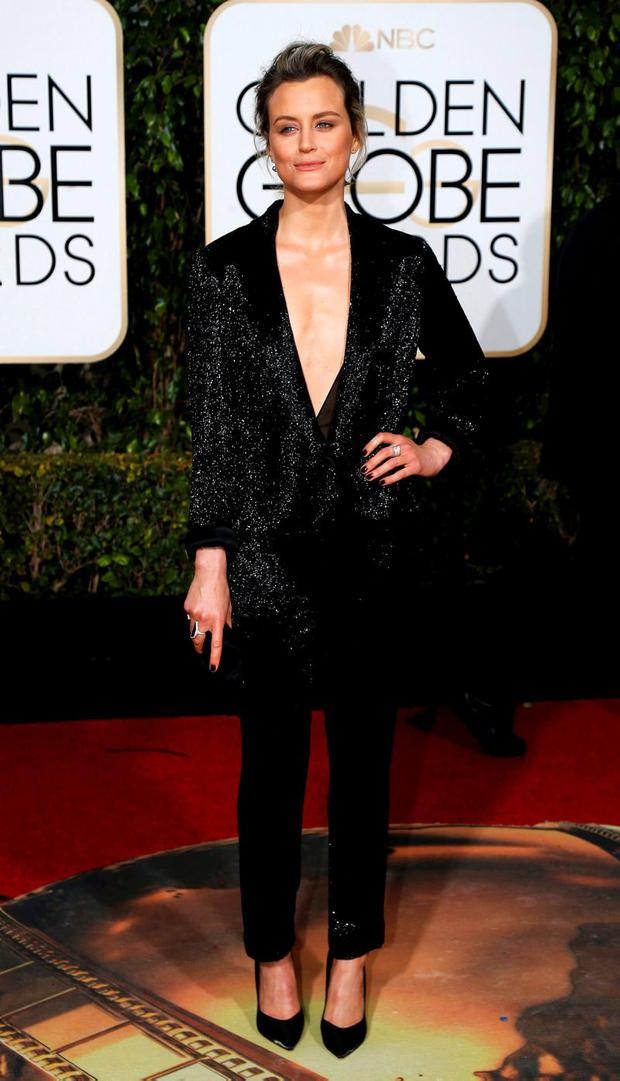Actress Taylor Schilling arrives at the 73rd Golden Globe Awards in Beverly Hills, California January 10, 2016. REUTERS/Mario Anzuoni