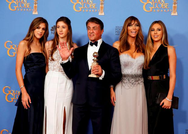 Sylvester Stallone and his wife Jennifer Flavin (2nd R) and their daughters, Sistine (L), Scarlet, (2nd L) and Sophia, pose with his award for Best Performance by an Actor in a Supporting Role in any Motion Picture for his role in
