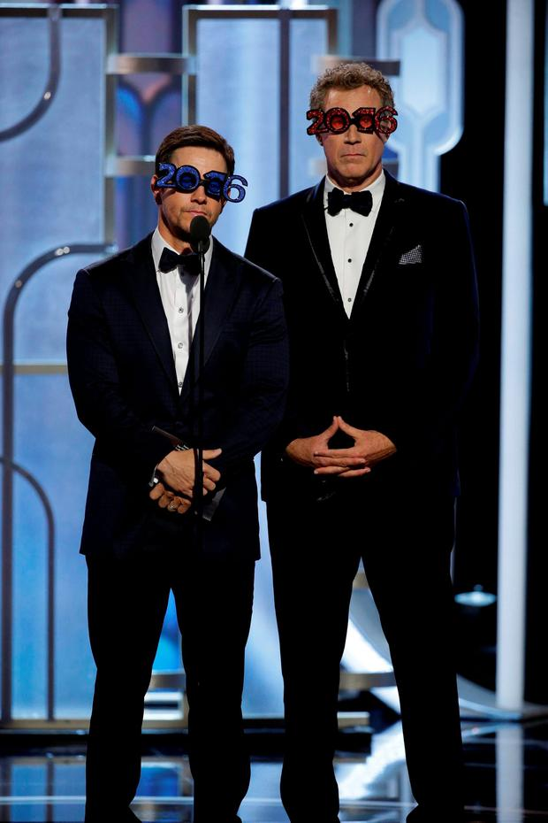 Mark Wahlberg (L) and Will Ferrell present at the 73rd Golden Globe Awards in Beverly Hills, California January 10, 2016. REUTERS/Paul Drinkwater/NBC Universal/Handout For editorial use only. Additional clearance required for commercial or promotional use. Contact your local office for assistance. Any commercial or promotional use of NBCUniversal content requires NBCUniversal's prior written consent. No book publishing without prior approval. TPX IMAGES OF THE DAY