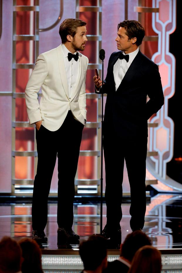 Ryan Gosling (L) and Brad Pitt present at the 73rd Golden Globe Awards in Beverly Hills, California January 10, 2016. REUTERS/Paul Drinkwater/NBC Universal/Handout For editorial use only. Additional clearance required for commercial or promotional use. Contact your local office for assistance. Any commercial or promotional use of NBCUniversal content requires NBCUniversal's prior written consent. No book publishing without prior approval.