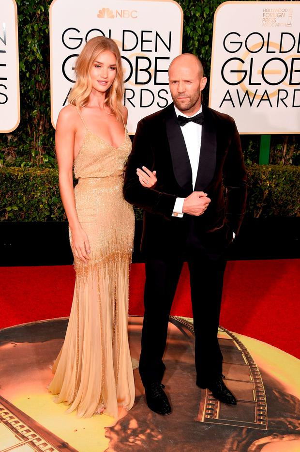 Actors Rosie Huntington-Whiteley and Jason Statham attend the 73rd Annual Golden Globe Awards held at the Beverly Hilton Hotel on January 10, 2016 in Beverly Hills, California. (Photo by Jason Merritt/Getty Images)