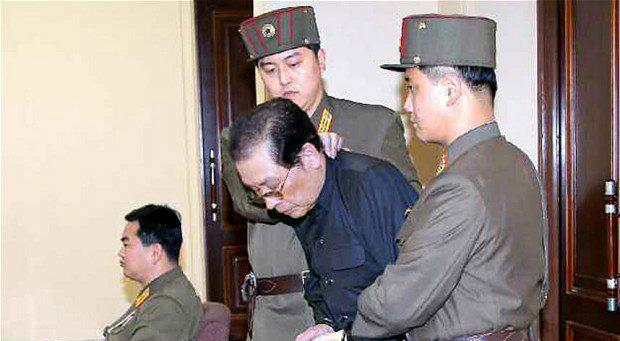 Jang Song-thaek, the uncle of North Korean leader Kim Jong-un, is escorted in to court