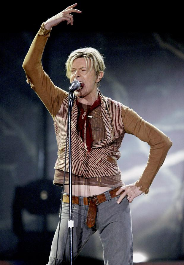 David Bowie performs on the first night of his UK tour at the MEN Arena on November 17, 2003 in Manchester, England. (Photo by Alex Livesey/Getty Images)