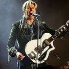 """David Bowie performs on stage on the third and final day of """"The Nokia Isle of Wight Festival 2004"""" at Seaclose Park, on June 13, 2004 (Photo by Jo Hale/Getty Images)"""