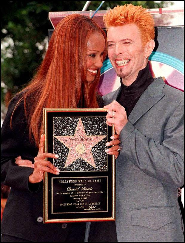 Rock music superstar David Bowie (R) and his wife, supermodel Iman smile as they pose for photos after Bowie received a star on the world famous Walk of Fame 12 February in Hollywood, CA. Bowie, whose changing persona has marked him as one of rock music's most dynamic performers over the last three decades, recently released his latest album